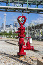 Red metallic fire hydrant in industrial plant Stock Photos