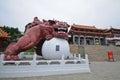 Red metallic guardian lion statur in Sun Moon Lake temple in Taiwan
