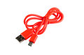 Red micro USB to USB cable Royalty Free Stock Photo