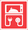 Microwave oven with dish Royalty Free Stock Photo
