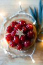 Red mini pie with ligths raspberry a star and christmas on a wooden table Stock Photography
