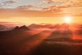Red misty daybreak foggy autumn morning in a beautiful hills peaks of hills are sticking out from rich colorful clouds background Stock Photography