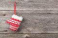 Red mitten on wooden background Royalty Free Stock Photography
