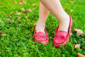 Red moccasins on childs feet close up of Royalty Free Stock Image