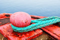 Red mooring bollard sea concept for very large boat over ocean Stock Photos