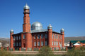Red mosque muslim at a country road russia north caucasus Stock Image