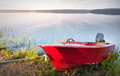 Red motorboat moored on the coast of Saimaa lake Royalty Free Stock Photography