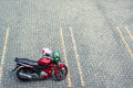 Red Motorcycle on empty car parking pavement Royalty Free Stock Photo