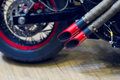 Red motorcycle exhaust pipe, modern style exhaust Royalty Free Stock Photo