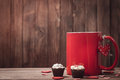 Red mug with coffee and chocolates on valentine s day space for text Royalty Free Stock Images