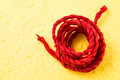 Red mulberry paper rope on yellow background sweet color Royalty Free Stock Photos