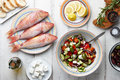Red mullet fish and mediterranean dishes cooking Royalty Free Stock Photo