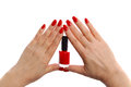 Red nail polish against the woman s hand Royalty Free Stock Image