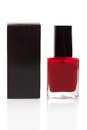 Red nail polish bottle and black box on white background Royalty Free Stock Photography