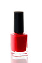 Red nail polish bottle over white on background Royalty Free Stock Image