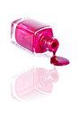 Red nail polish bottle with splatters Stock Photos