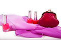 Red nail polish and red purse on white background Royalty Free Stock Photo
