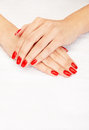 Red nails closeup image of manicure on top of towel Stock Photo