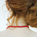The red necklace. Back view. Royalty Free Stock Photo