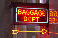 Red neon sign indoor depot signage arrow points baggage dept a the way to the in the train station Royalty Free Stock Photos