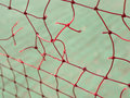 Red net rip with green backgrounds Stock Images