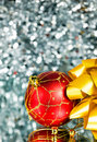 Red New Year s ball and gold bow Stock Photo