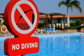 Red no diving warning sign at the poolside Royalty Free Stock Photo