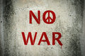 Red No War message and peace symbol graffiti on grunge ciment wa