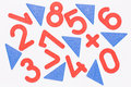 Red numbers and blue triangles bright randomly scattered on a white background Royalty Free Stock Photos