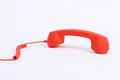Red off hook telephone receiver on white background Stock Photography