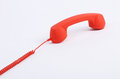 Red off hook telephone receiver on white background Stock Images
