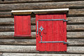 Red old door and window on the wooden wall of a village house. Excellent background. Royalty Free Stock Photo