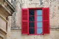 Red old window in the old city of mdina malta Stock Photo