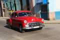 Red oldtimer in Havana street Royalty Free Stock Photo