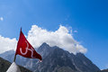 Red om flag in the indian himalayas a with hindu symbol fluttering mountain wind Stock Photos