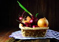 Red onion and onion in a wicker basket Royalty Free Stock Photo