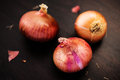 Red onions fresh on a wooden background Stock Photo