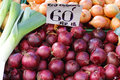 Red onions for sale at farmers market Royalty Free Stock Image