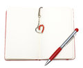 Red open notepad (paper) with pen and heart bookmark Royalty Free Stock Image