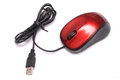 A red optical wired USB computer mouse against a white backdrop Royalty Free Stock Photo