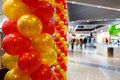 Red and orange balloons in mall. Royalty Free Stock Photo
