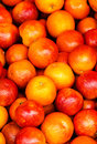 Red orange fruit background pile of orange in a market stall food Royalty Free Stock Photos