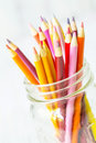 Red Orange Yellow Colored Pencils In Glass Jar On White Royalty Free Stock Photo