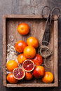 Red oranges ripe on textured wooden background Royalty Free Stock Images