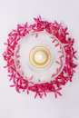 Red orchid circle with bowl and candle Royalty Free Stock Images