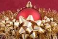 Red Ornament Gold Garland and Gold Bows Royalty Free Stock Photo