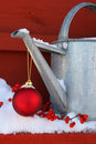 Red ornament on watering can Stock Image