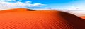 Red sand dune with ripple and blue sky Royalty Free Stock Photo