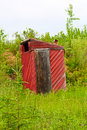 A red outhouse along a hiking trail Royalty Free Stock Photo