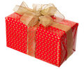 Red package with gold bow Royalty Free Stock Photo